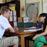 Bivi Goto conducts an oral Spanish language evaluation with Thomas.