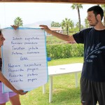 Neal, with Gretchen's help, teaches students the words of an Ashaninka song.
