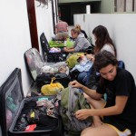 Gretchen, Maria, Gina and other students repack their luggage.