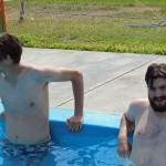 Thomas and Jonathan cool off in the swimming pool.