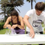 Recreating a popular Peruvian TV show, Gretchen and Caleb compete to see who can stack cups the fastest.