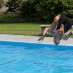 Jackson flips backward into the pool.