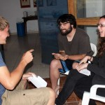 Dean, portraying a returning Peru SST student, talks with Jonathan and April during a role-play exercise.