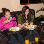 Malaina and April enjoy their dinner.