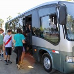 Students board the bus to return to Lima.