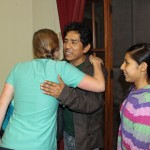 Emma greets her host father and sister with the Peruvian air kiss. The students practiced greetings on each other before meeting their families.