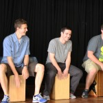 Joel, Derek, Brian, Michael and Stefan learn how to play the cajón.