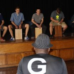 Camilo Ballumbrosio teaches students how to play the cajón.