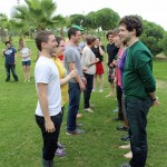 Stefan, Brody and other students play a game to learn each other's names.