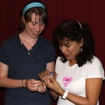 Leah gives her host mother a Goshen College button.