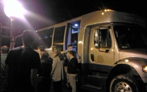 Students prepare to depart for O'Hare International Airport in Goshen College's bus.