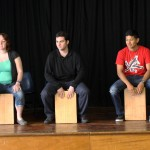 Jamie, Sierra, Andrew, Alejandro and Derek get a lesson from Camilo Ballumbrosio in how to play the cajón.