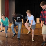 Stefan, Miranda, Emma and Michael learn new dance steps from Camilo Ballumbrosio.