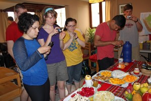 Edith, Leah, Miranda, Alejandro and Michael take photos of Peruvian fruit.
