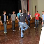 Students try to replicate Camilo's complex dance steps.