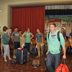 Tim's turn to gather his luggage and say good-bye to the group.