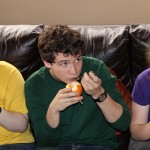Miranda, Brody and Leah taste granadilla.
