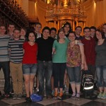 A group photo in front of the main altar in the Cathedral of Lima.
