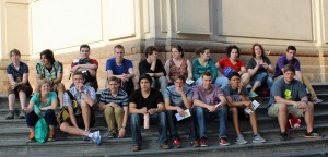 Students wait for a bus outside the Cathedral of Lima.