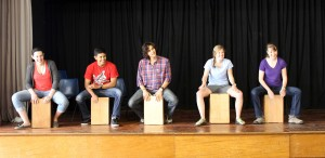 Jamie, Alejandro, Lucas, Emma and Leah learn how to play the cajón.