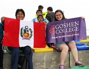 Holding symbols of Peru and Goshen College are Miranda and Livia Salas Achahuanco, host mother of Alejandro.