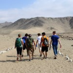 Students hike toward Caral.