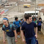 Leah, Andrew and other students walk toward the Anglican mission in Puente Piedra.