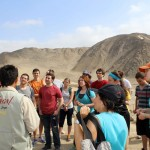 A tour guide describes the significance of Caral.