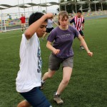 A Peruvian student and Leah seek control of the ball.
