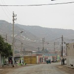 The view of a very poor hillside neighborhood in the Puente Piedra district of Lima.