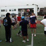 Players gather on the soccer field to select teams.