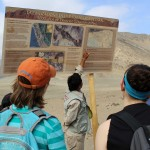 A tour guide makes a point about Caral.