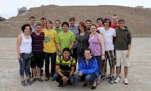 Stopping for a group photo in front of the pyramid