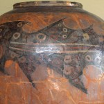 This pot was reconstructed from fragments. It has a whimsical shark design.