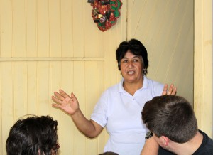 Livia Salas Achahuanco thanks students for their work at the Anglican mission.