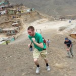 Andrew, Leah and other students sprint toward the summit of a small mountain at Puente Piedra.
