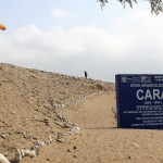 A sign welcoming visitors to Caral, the oldest city in the Americas.