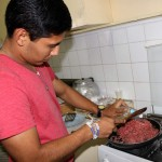 Alejandro cooks the ground beef