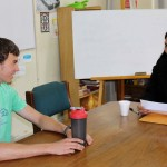 Joel takes his oral Spanish evaluation with his teacher, Gretty Garcia.