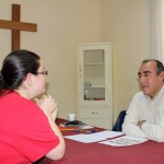 Miranda takes her Spanish oral evaluation with her teacher, Moises Arce.