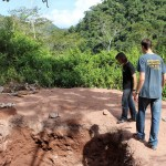 Lucas and Joel show a septic pit they helped dig.