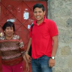 Alejandro with his host mother, Ercilia, in front of her home.