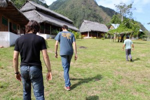 Lucas and Joel and Kimo Director Henry Viguria walk toward the camp.