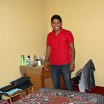 Alejandro in his bedroom.