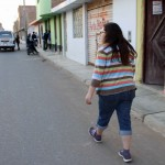 Miranda strolls toward her host family's home.