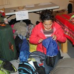 Edith finishes her packing.