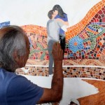 We find the artist at work on a new canvas depicting the Parque del Amor.