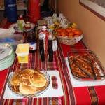 Breakfast is served: pancakes, sausage, fruit, coffee and tea.