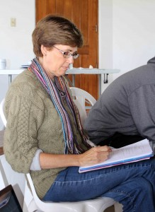 Peru SST Co-Director Judy Weaver takes notes on the student presentations.