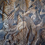 Another portion of Victor Delfin's wood carving depicts atrocities by Shining Path rebels.